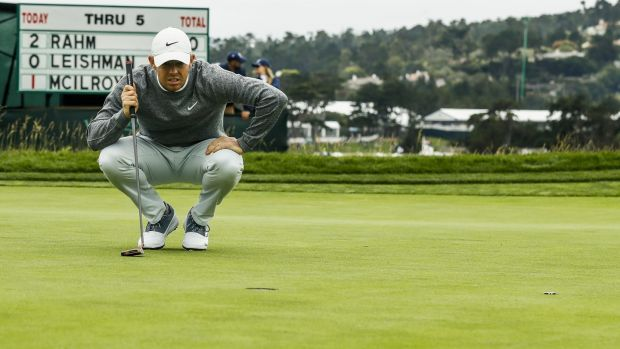 McIlroy lines up his putt on the sixth green during the second round. Photo: Etienne Laurent/EPA