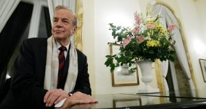 Italian film director Franco Zeffirelli poses at the British embassy in Rome before receiving the medal of knighthood from the British ambassador to Italy in 2004. File photograph: Paolo Cocco/AFP/Getty Images