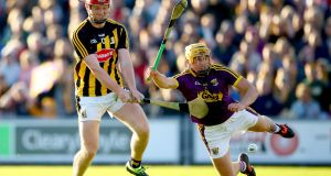 Kilkenny's Adrian Mullen scores his side's opening goal despite the attempt of Damien Reck of Wexford to block his shot during the Leinster SHC round-robin game at Wexford Park. Photograph: James Crombie/Inpho
