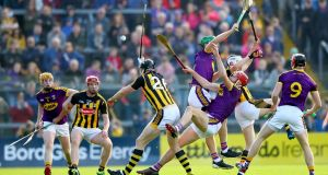 Kilkenny's Walter Walsh and TJ Reid in action against Kevin Foley and Paudie Foley of Wexford during the Leinster SHC round-robin game at Wexford Park. Photograph:  James Crombie/Inpho