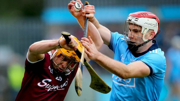 Dublin's Paddy Smyth challenges David Glennon of Galway during the Leinster SHC round-robin game at Parnell Park. Photograph: Ryan Byrne/Inpho