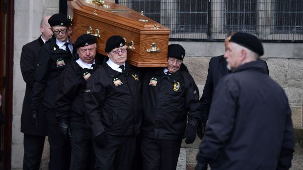 Billy McKee's coffin is carried during his funeral procession in Belfast. Photograph: Charles McQuillan/Getty Images