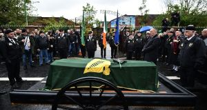The funeral of veteran Irish republican Billy McKee is given a guard of honour by D Company members, former IRA members and prisoners as it stops at the republican Garden of Remembrance on in Belfast. Photograph: Charles McQuillan/Getty Images