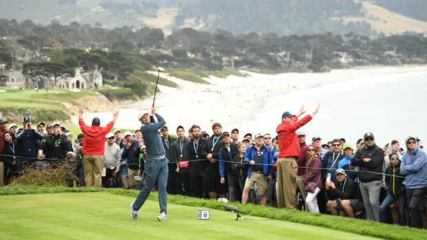 Justin Rose drives from the 14th tee during the third round of the US Open at Pebble Beach. Photograph: Harry How/Getty Images