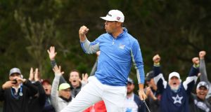 Gary Woodland celebrates a par-saving putt on the 12th green during the third round of the  US Open at Pebble Beach in California. Photograph:  Harry How/Getty Images
