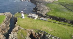 The two cottages once used by  lighthouse keepers are on a seven acre plot which is for sale on Rathlin O Birne Island off Co Donegal. Photograph: DNG Dorrian/MyHome.ie