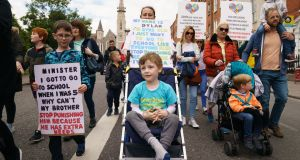 Julieann McGovern and sons Dylan (5) and Cillian (7) from Drimnagh at a  protest over special needs in Dublin organised by Enough is Enough. Photograph: Fran Veale