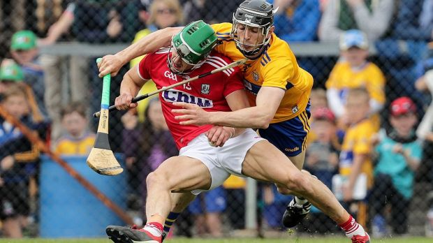Clare's David McInerney challenges Cork's Alan Cadogan during the during the Munster SHC round-robin match at Cusack Park in Ennis. Photograph: Laszlo Geczo/Inpho