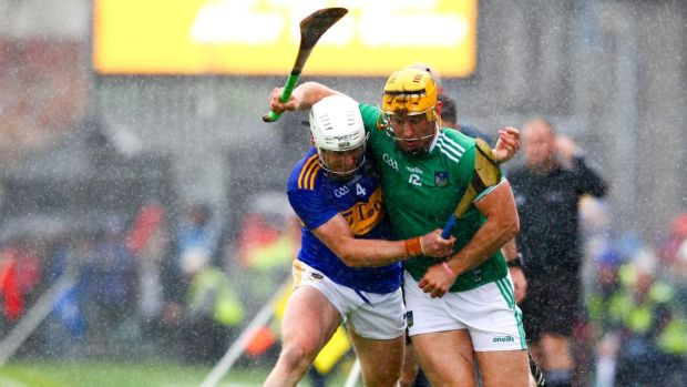 Tipperary's Seán O'Brien tackles Limerick's Tom Morrissey during the Munster SHC round-robin game at Semple Stadium. Photograph: Ken Sutton/Inpho