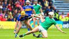 Limerick's Kyle Hayes battles with  Tipperary's Ronan Maher  during the Munster SHC round-robin game at Semple Stadium. Photograph: Ken Sutton/Inpho
