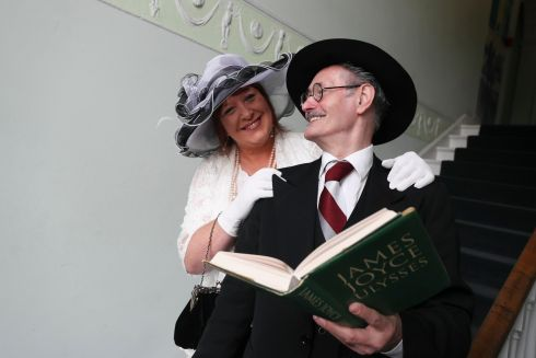 Caroline Elbay, from Santry, is greeted at the James Joyce Centre on North Great George's Street, Dublin, by the author, played by John Shevlin, for the traditional Bloomsday celebrations. Photograph: Conor McCabe Photography