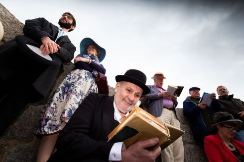 Ken Forsyth and other Joyceans read from Ulysses at the Martello Tower at Sandymount in Dublin on Bloomsday. Photograph: Tom Honan