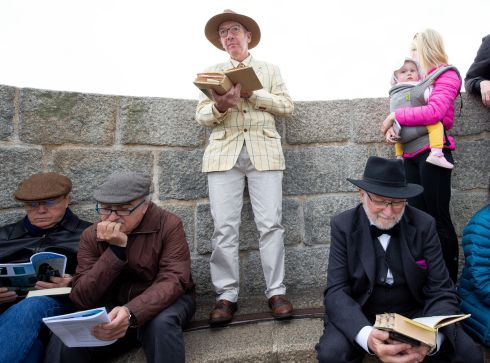 From left to right are  Santiago Brœ and  Ximo Ferreres (sitting), both from Spain, Des Gunning (standing) and Pat O' Connell. Also present are Natalie Curtin and her daughter Lucy (15 months), for a reading of Ulysses at the Martello Tower at Sandymount. Photograph: Tom Honan