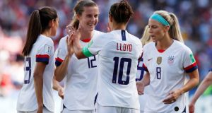 Carli Lloyd of the USA celebrates with her team mates after scoring their third goal. Photograph: Christian Hartmann/Reuters