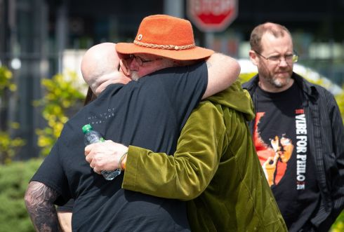 PHILOMENA'S PASSING: Ian Longdin, from Manchester, embraces Gerry Jago (in green jacket), a former roadie with Thin Lizzy, at Stafford's Funeral Home in Portmarnock, Co Dublin, for the repose of the remains of Philomena Lynott, mother of Thin Lizzy singer Phil Lynott. Photograph: Tom Honan