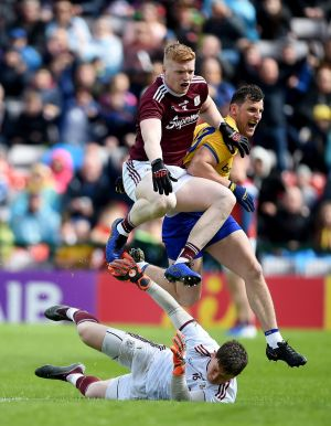 CONNACHT CLASH: Galway's Ruairi Lavelle (goalkeeper, on ground) and Sean Andy O Ceallaigh in action against Diarmuid Murtagh of Roscommon (right) in the Connacht GAA Senior Football Championship Final, Pearse Stadium, Galway. Roscommon were victorious. Photograph: Tommy Grealy/Inpho