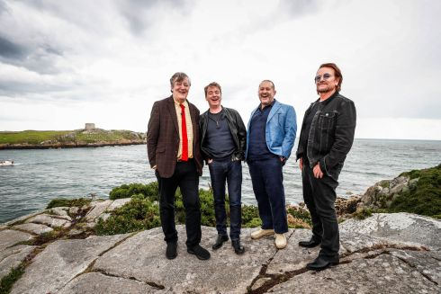 BOOKISH CHARACTERS: Writer Stephen Fry, festival organiser David McWilliams, chief design officer of Apple, Jony Ive, and U2 frontman Bono at Seafront Marquee, Dillon's Park, Dalkey, during the Dalkey Book Festival.  Photograph: Conor McCabe Photography