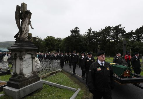 REPUBLICAN SEND-OFF: The coffin of founding member of the Provisional IRA, Billy McKee, is accompanied by members of the republican D Company as it enters Milltown cemetery in Belfast. Photograph: Brian Lawless/PA Wire