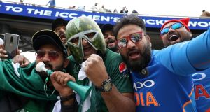 India and Pakistan fans show their support during their ICC Cricket World Cup group stage match at Emirates Old Trafford, Manchester. Photograph: PA
