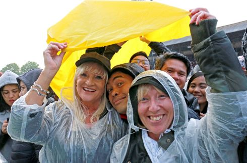 Bon Jovi fans aren't deterred by the heavy rain. Photo: Crispin Rodwell for the Irish Times