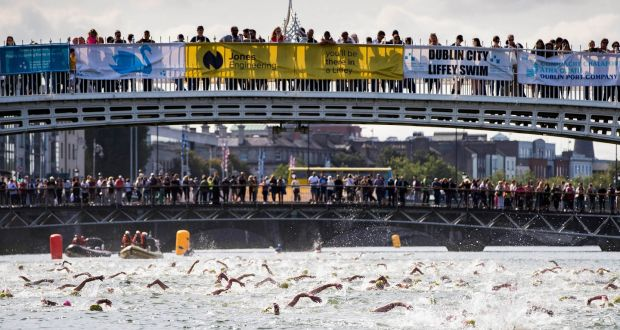 Competitors make their way down the Liffey last year. Photo: Ryan Byrne/Inpho