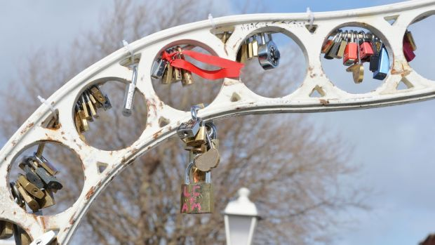 Love locks on the Ha'Penny Bridge: Emails show Dublin City Council has considered erecting a sculpture on the quays to attract the locks away. Photograph: Alan Betson