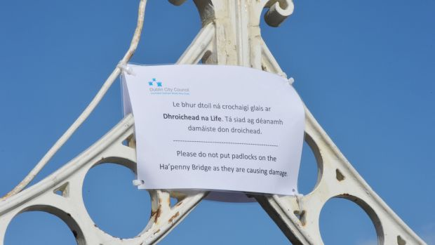 Dublin City Council sign requesting lovers not to attach locks to the Ha'Penny Bridge. Photograph: Alan Betson