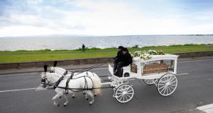 The funeral hearse  of Phillomena Lynott passes the seafront in Sutton, Dublin. Photograph: Tom Honan/The Irish Times.