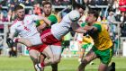 Tyrone's Matthew Donnelly is tackled by Donegal's Hugh McFadden during their Ulster SFC clash. Photo: Evan Logan/Inpho