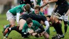 Ireland's David Ryan is tackled during the World Junior Championship match against England. Photo: Pablo Gasparini/Inpho