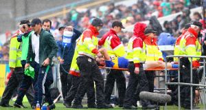 Tipperary's Patrick Maher leaves the pitch injured in Thurles. Photograph: Ken Sutton/Inpho