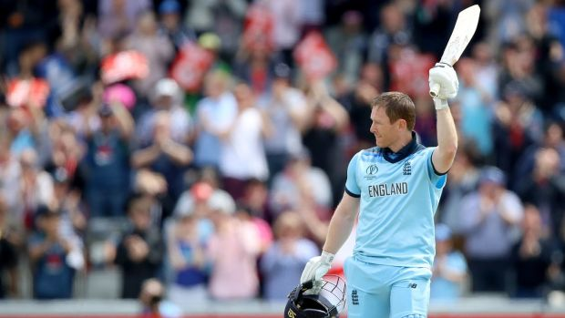 England's Eoin Morgan raises his bat after reaching his century against Afghanistan. Photograph: Tim Goode/PA