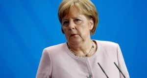 "German chancellor Angela Merkel:  possible link between the killing and the far-right is ""depressing"". Photograph: Odd Andersen"
