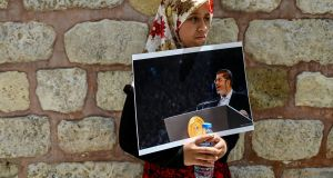 A girl holds a photograph of former Egyptian president Mohamed Morsi during a symbolic funeral ceremony on June 18th at Fatih mosque in Istanbul. Thousands joined in prayer in the Turkish capital for Morsi, who died after collapsing in a Cairo court. Photograph: Getty Images