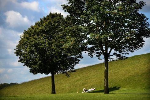 ENJOY THE SILENCE: Relaxing in the sunshine in the Phoenix Park, Dublin on Tuesday. Photograph: Dara Mac Donaill