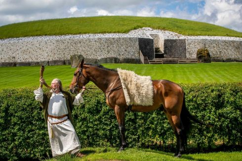 RITE OF PASSAGE: Ruarí Ó Coileáin with 'George' the Horse outside Newgrange at the launch of the Boyne Valley Racing Weekend. Photograph: Morgan Treacy/Inpho