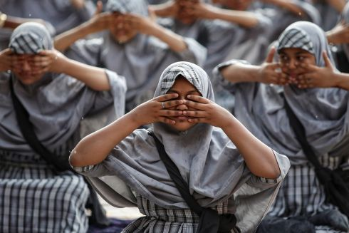 INTERNATIONAL YOGA DAY: Muslim students attend a yoga lesson at a school ahead of International Yoga Day in Ahmedabad, India. Photograph: Amit Dave/Reuters