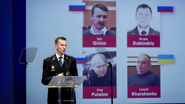 MH17: Wilbert Paulissen of the Joint Investigation Team at the press conference in Nieuwegein, The Netherlands The alleged suspects named are Igor Girkin, Oleg Pulatov, Sergey Dubinsky, Leonid Kharchenko. Photograph: Robin van lonkhuijsen/EPA
