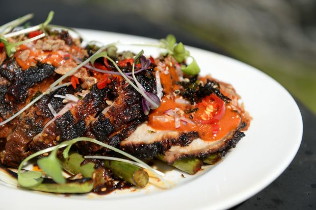 Ian Marconi's Asian-style barbecued pork loin with Korean chilli seaweed sauce and charred greens. Photograph: Dara Mac Dónaill