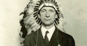 Éamon de Valera wearing a native American ceremonial head-dress. He was made chief of a Chippewa tribe of Indians at the Chippewa Reservation Reserve, Wisconsin when he visited it on October 18th, 1919. Photograph: taken from Judging Dev, by Diarmaid Ferriter, published by Royal Irish Academy