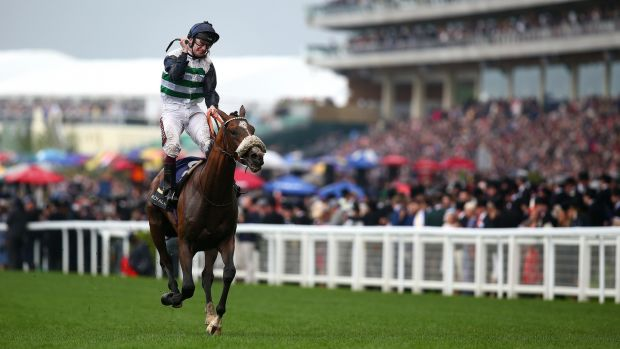 Oisin Murphy celebrates after he rides Dashing Willoughby to win The Queen's Vase. Photograph: Charlie Crowhurst/Getty