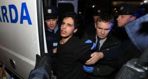 Mohamed Morei (19) being brought to Dundalk District Court last year where he was charged with the murder of Yosuke Sasaki in Dundalk. Photograph: Colin Keegan, Collins Dublin