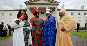 WELCOME VISITORS: Members of Waterford Integration services Suha Abdel, Obianuju Ekedozie, Osas Iyamu Usideme and Funmi Ganiyu at Áras an Uachtaráin for a garden party with President Michael D Higgins and his wife Sabina. Photograph: Nick Bradshaw
