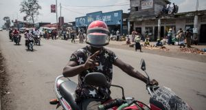 A motorbike driver poses on a busy street in Goma, eastern DRC. Ebola response workers remain concerned the virus could spread to the border city. Photograph: Sally Hayden