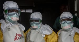 Healthcare workers put on protective gear at Goma's only Ebola treatment centre. They're  supposed to wear these outfits for a maximum of only 45 minutes, because of how hot it becomes inside. Photograph: Sally Hayden