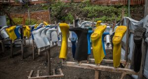 Wellies and gloves hang out to dry after being sprayed with chlorine and water, in Goma's only Ebola treatment centre. Photograph: Sally Hayden
