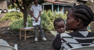 A female volunteer sits with her baby at a educational meeting about Ebola in Goma, eastern DRC. The meeting is part of a community outreach initiative aimed at preparing in case the outbreak spreads to the city. Photograph: Sally Hayden