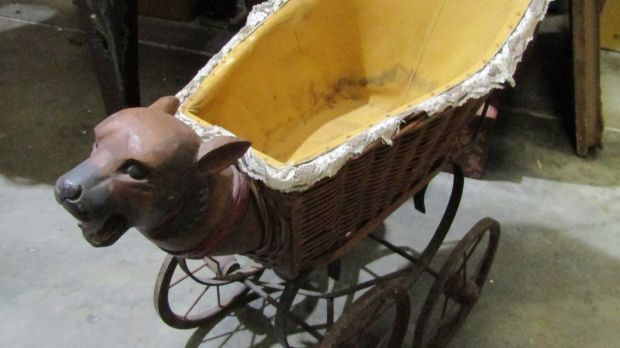 Victorian Pram with dogs head €150–€250 at Matthews Auction