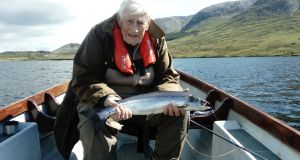 Regular visitor to Lough Inagh, Seamus Mallon from Armagh, landed this fresh salmon from the lake on a size 10 Connemara Black.
