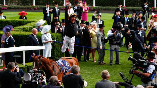 Jockey Frankie Dettori jumps off Stradivarius after winning the Gold Cup at Royal Ascot. Photograph: Adrian Dennis/AFP/Getty Images